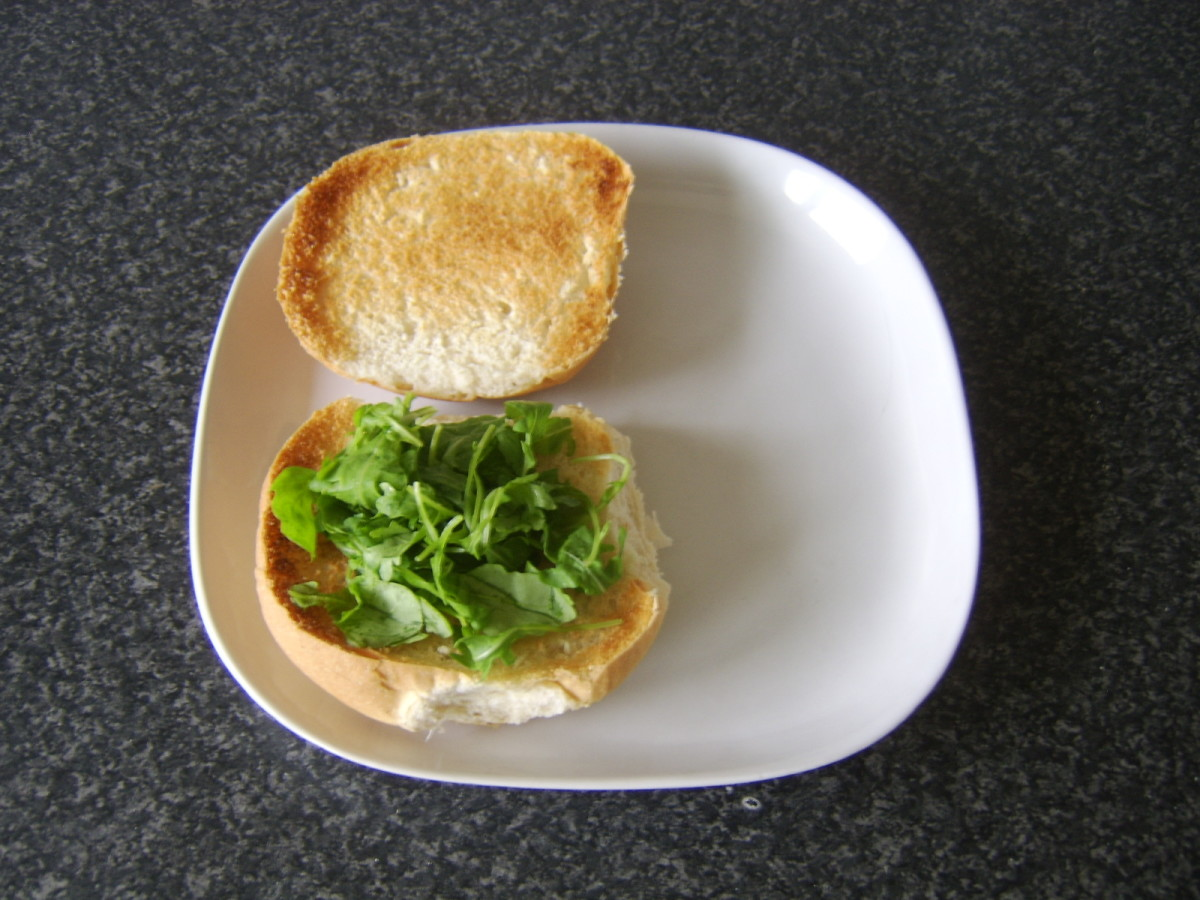 Rocket/arugula is added to bottom of roll