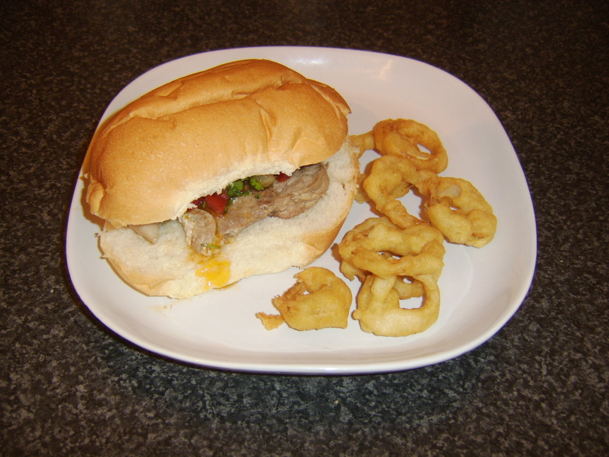 Burger style pork leg and salsa steak sandwich with onion rings