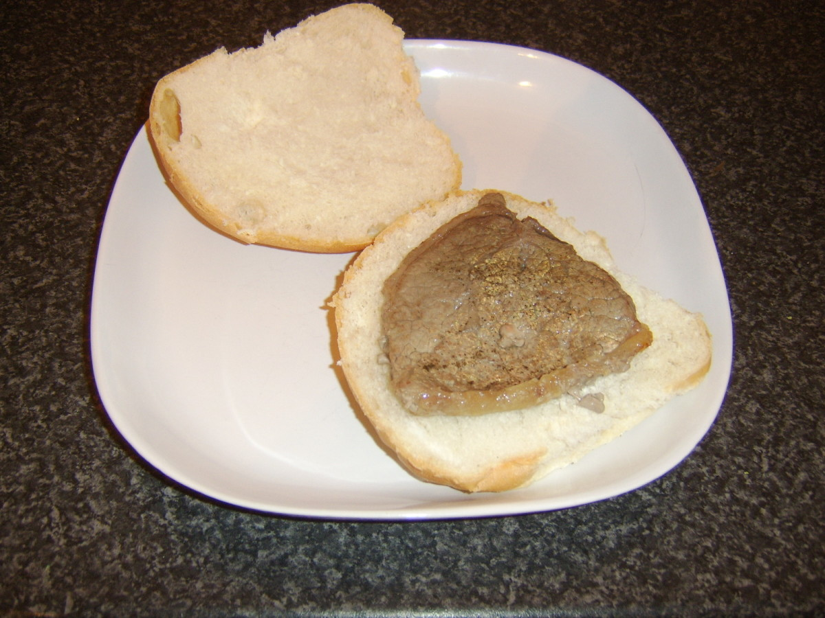 Rested steak is laid on bread roll