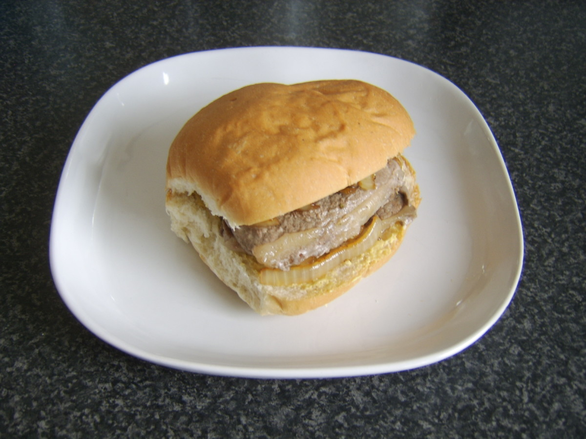 Assembled steak, mustard, mushroom and onion sandwich