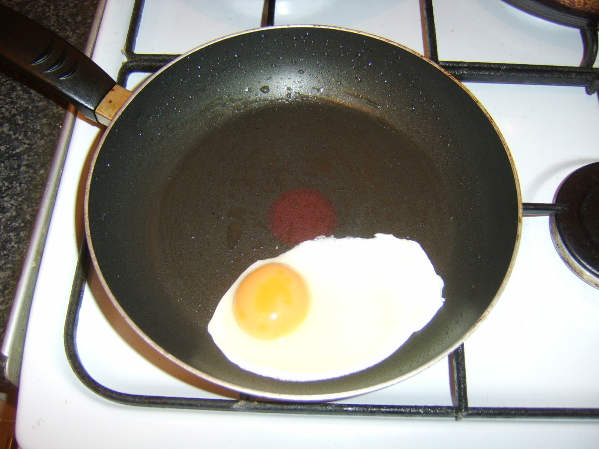 Egg is fried in a separate pan