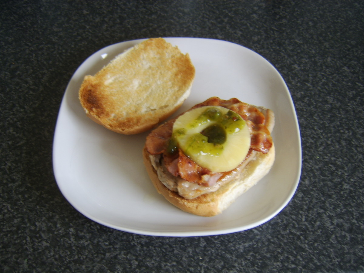 Leg of pork steak, bacon and pineapple with green jalapeno relish sandwich