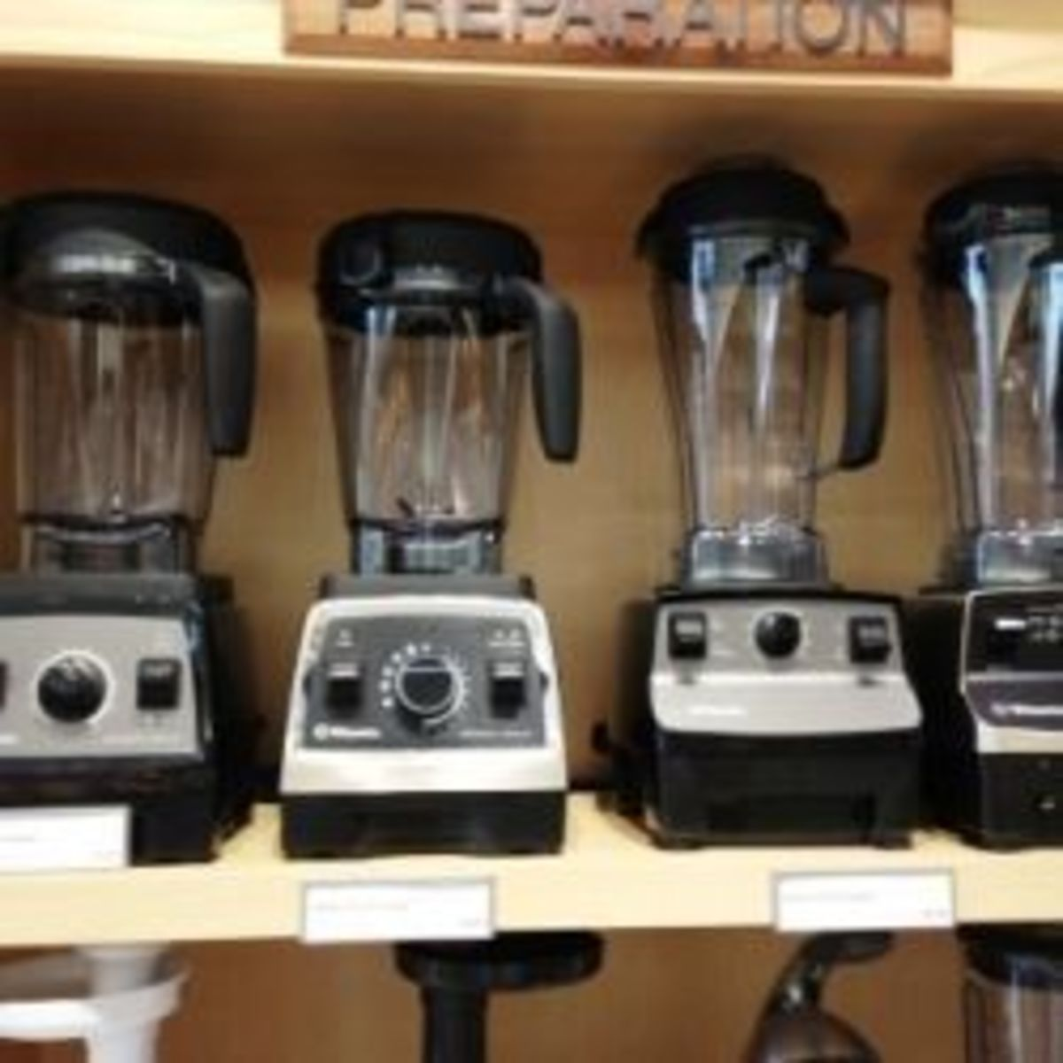 This is my photo of the Vitamix line up at the local retailer. Notice the height difference of the two on the left (Professional Series 300 and 750) compared to the taller older models on the right (5200 and 500).