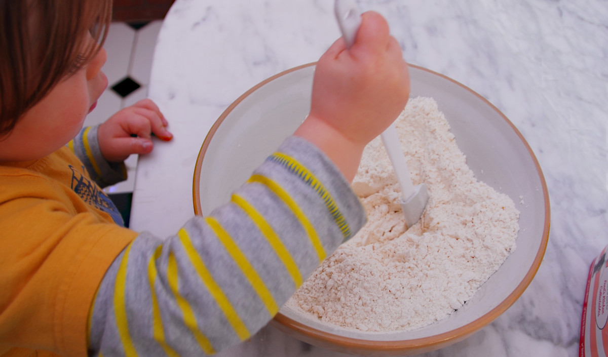 Making a well in the dry bread mix.