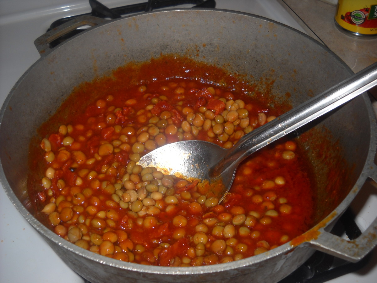 Add the pigeon beans. Let the mixture boil a little.