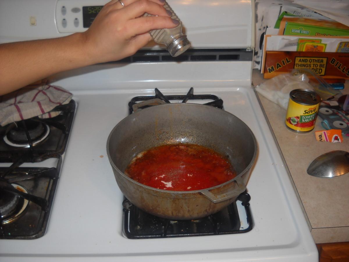 Add the pepper and salt.