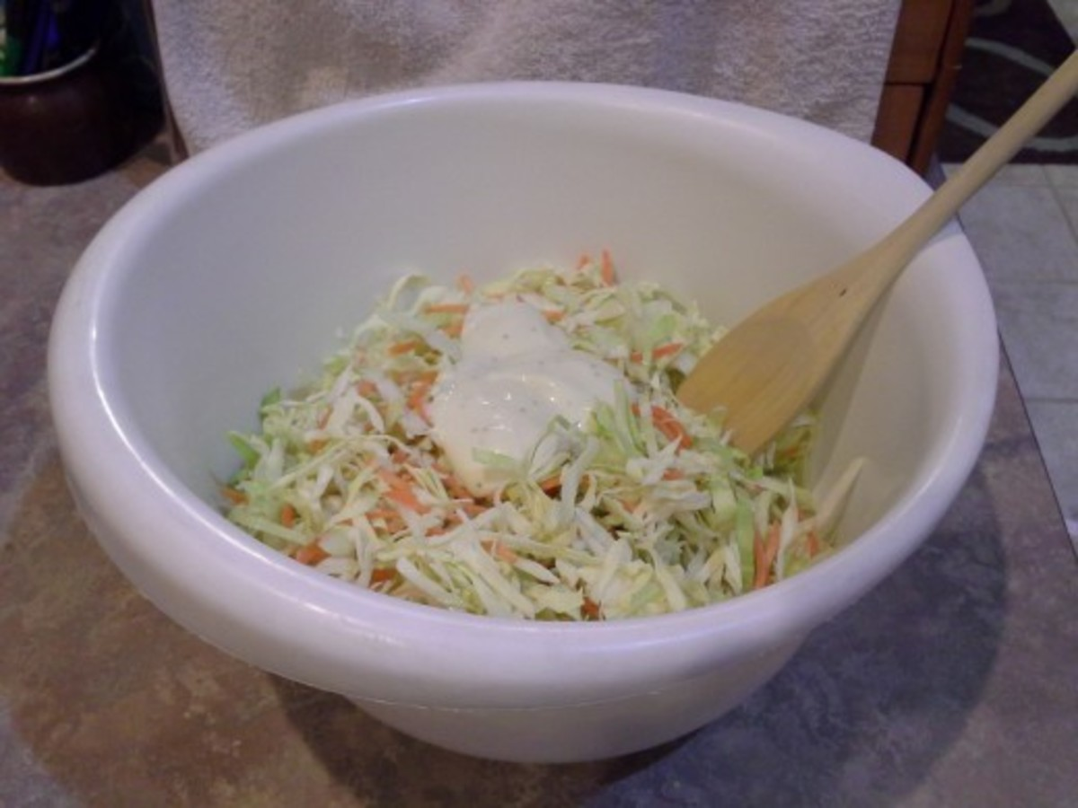 Shred your veggies and add in your coleslaw dressing.