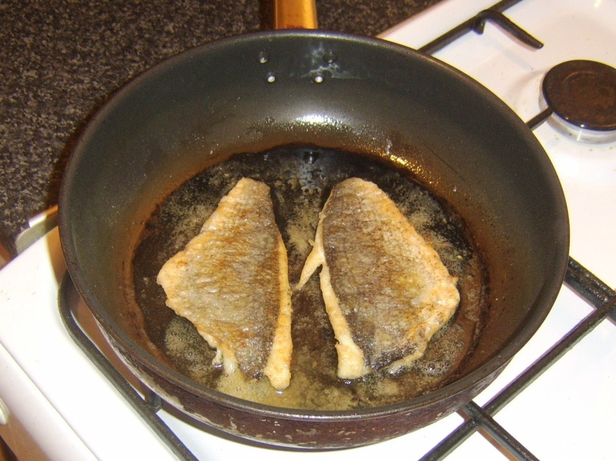 Sea bream fillets are carefully turned on to flesh sides