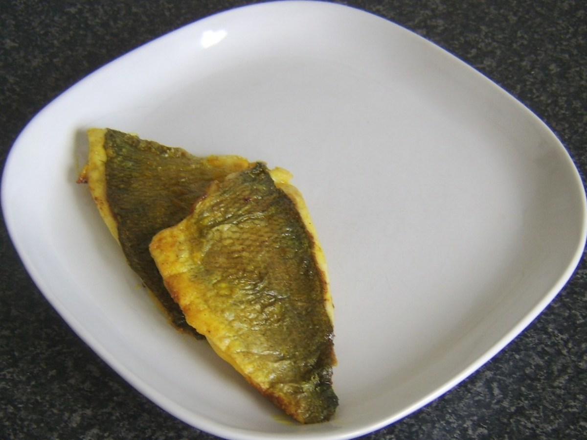 Curried sea bream fillets are plated