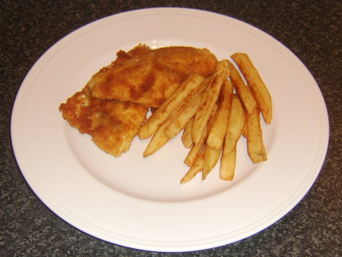 Chips are plated with the breaded sea bream fillets
