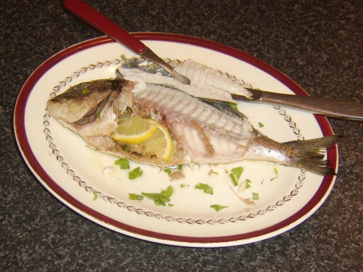 Tucking in to a whole baked sea bream
