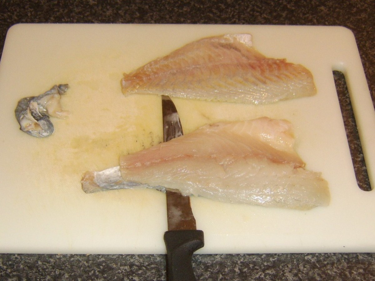 Starting to skin a sea bream fillet