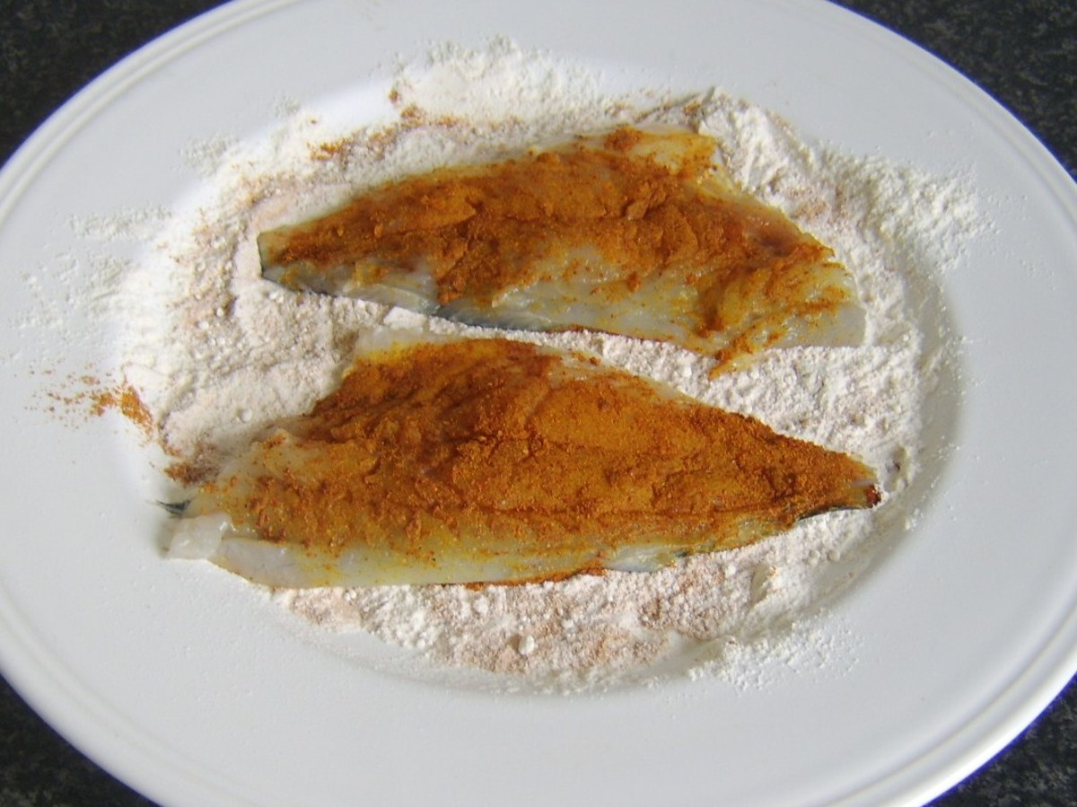 Skin sides or sea bream fillets are patted in seasoned flour