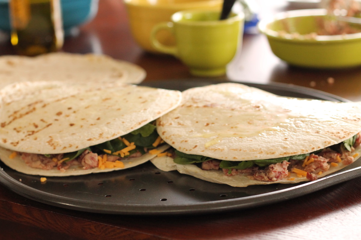 Add the tortilla shells to the top of the quesadillas.