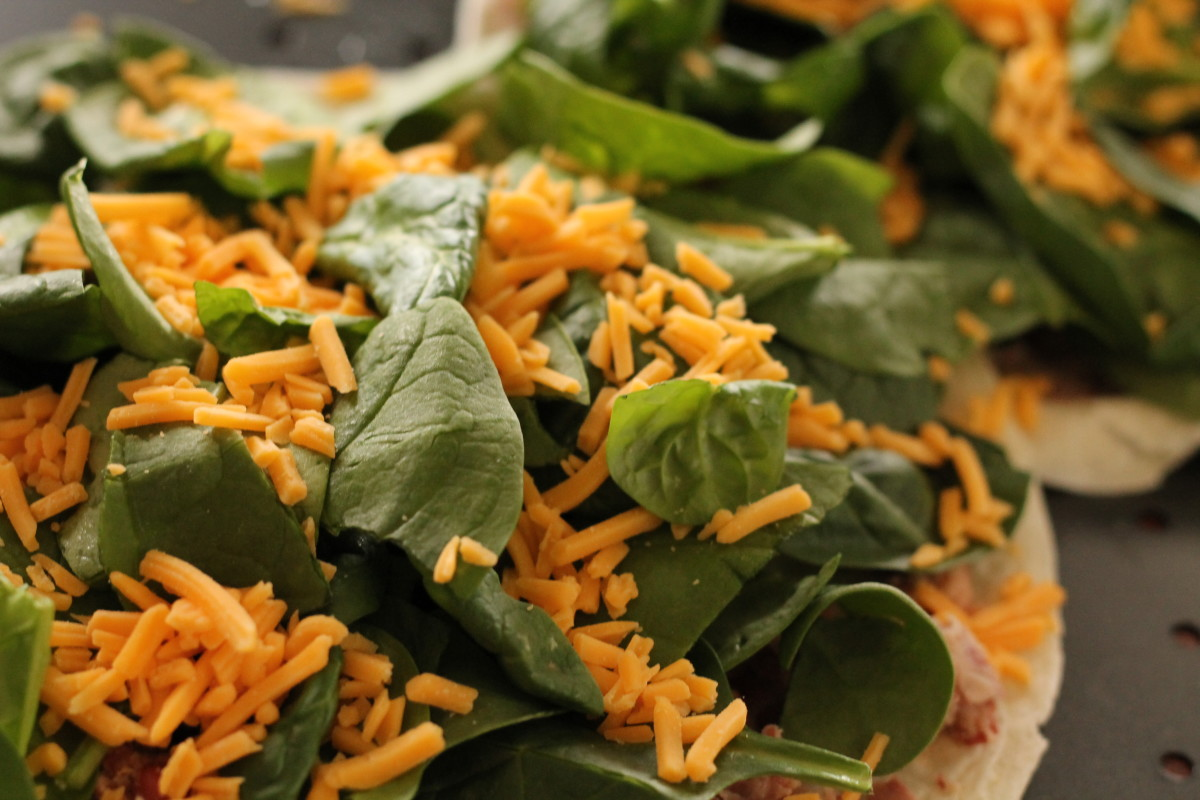 Sprinkle the cheese on top of the spinach.