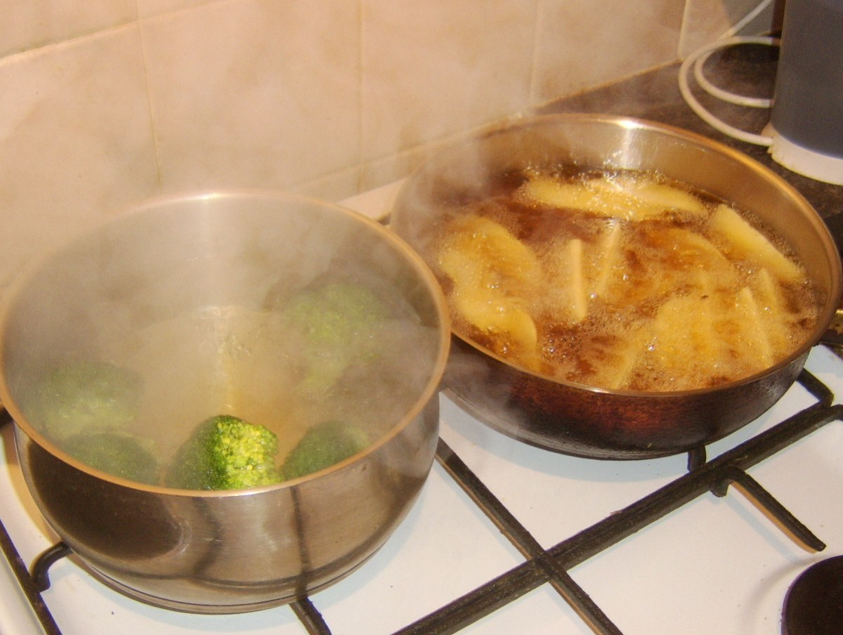 Broccoli is poached while potato wedges are deep fried