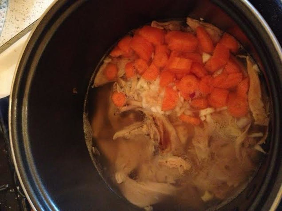 Add the carrot and garlic to the broth mix.  Let it cook for 5 minutes.