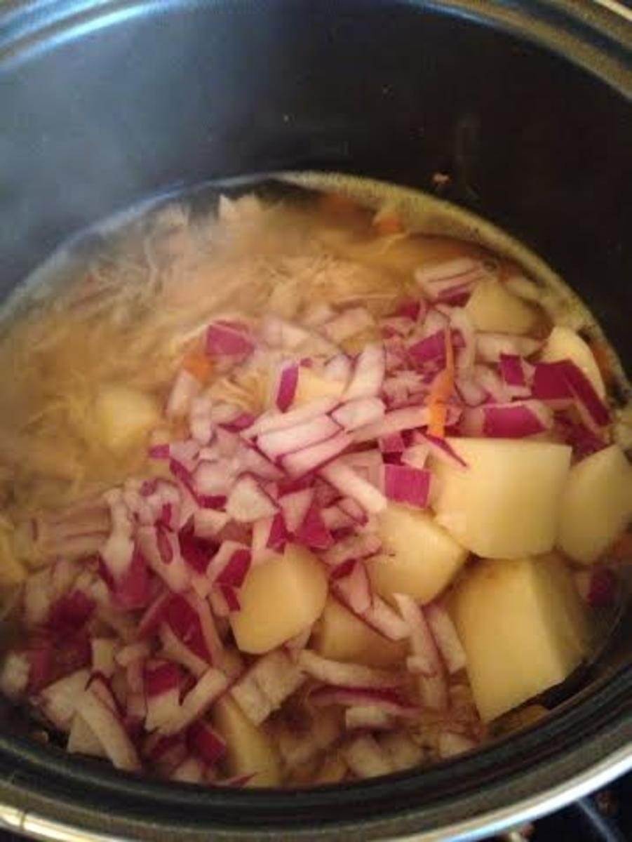Add the onion and potato and allow the filling to cook until the potatoes and carrots are almost fully cooked.
