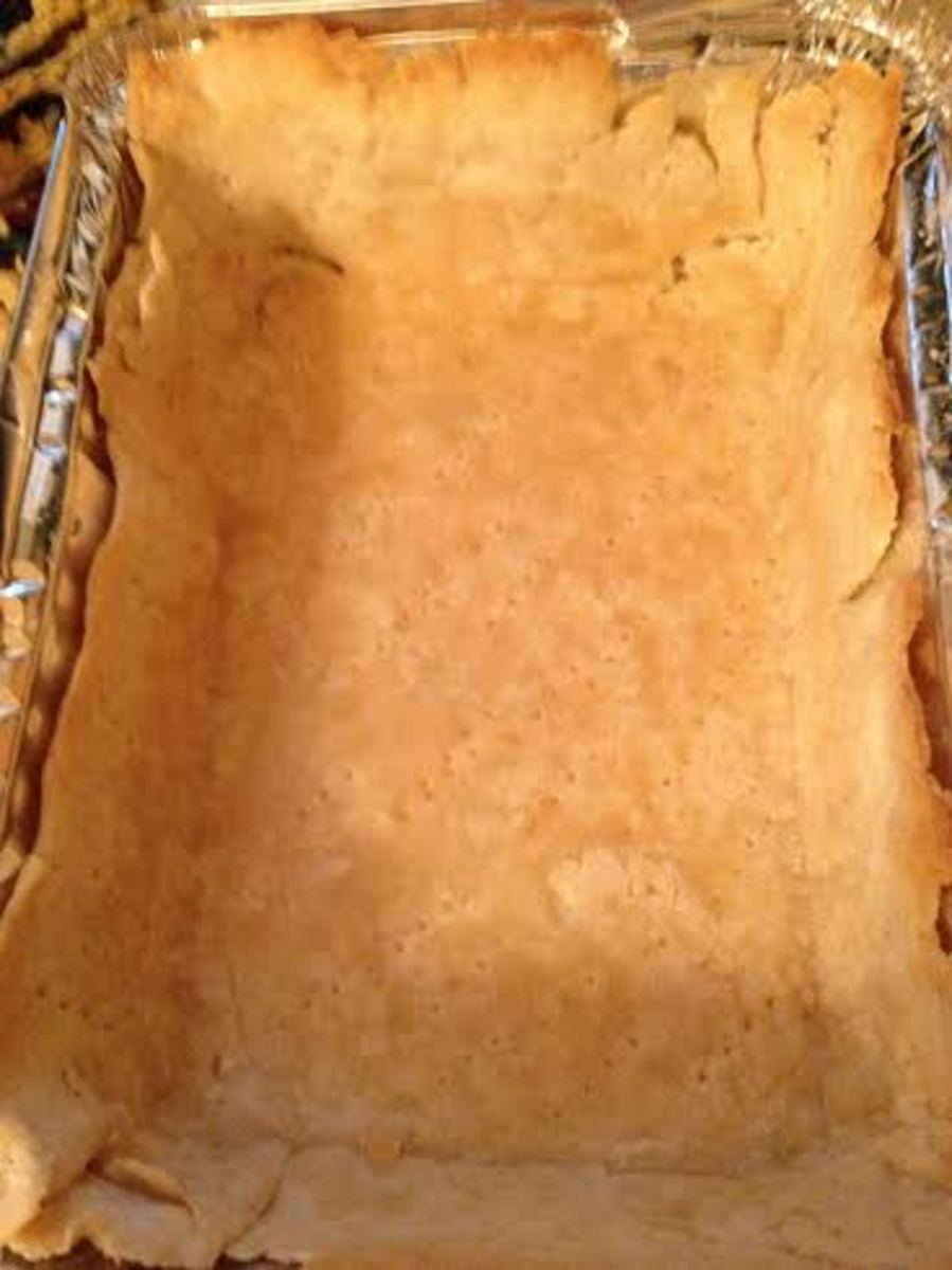 After baking, remove the parchment paper and it's contents.  Your crust is now ready for the filling.