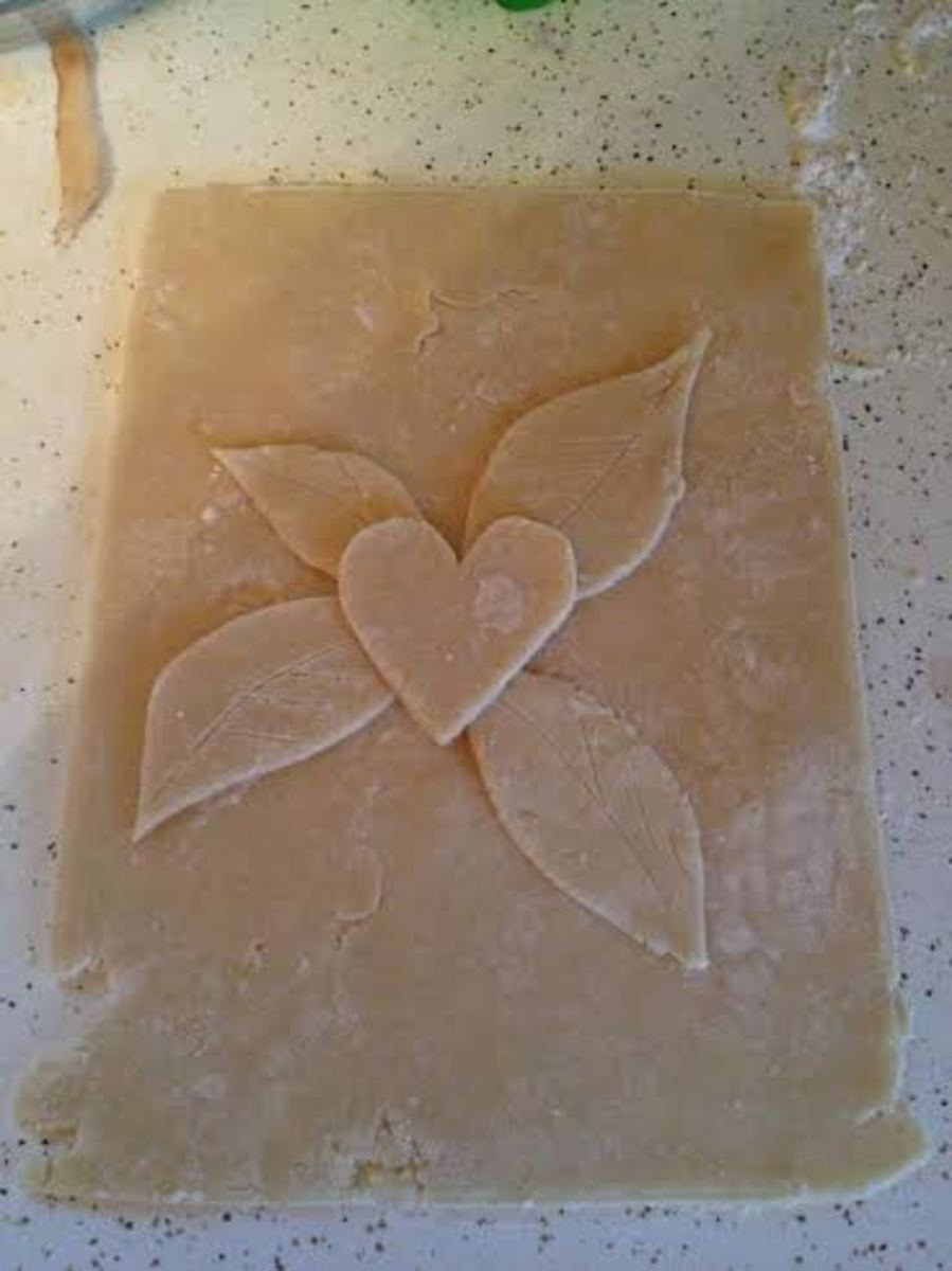I chose leaves and a heart to decorate the top crust.  Here I'm checking to make sure the decorations will fit.