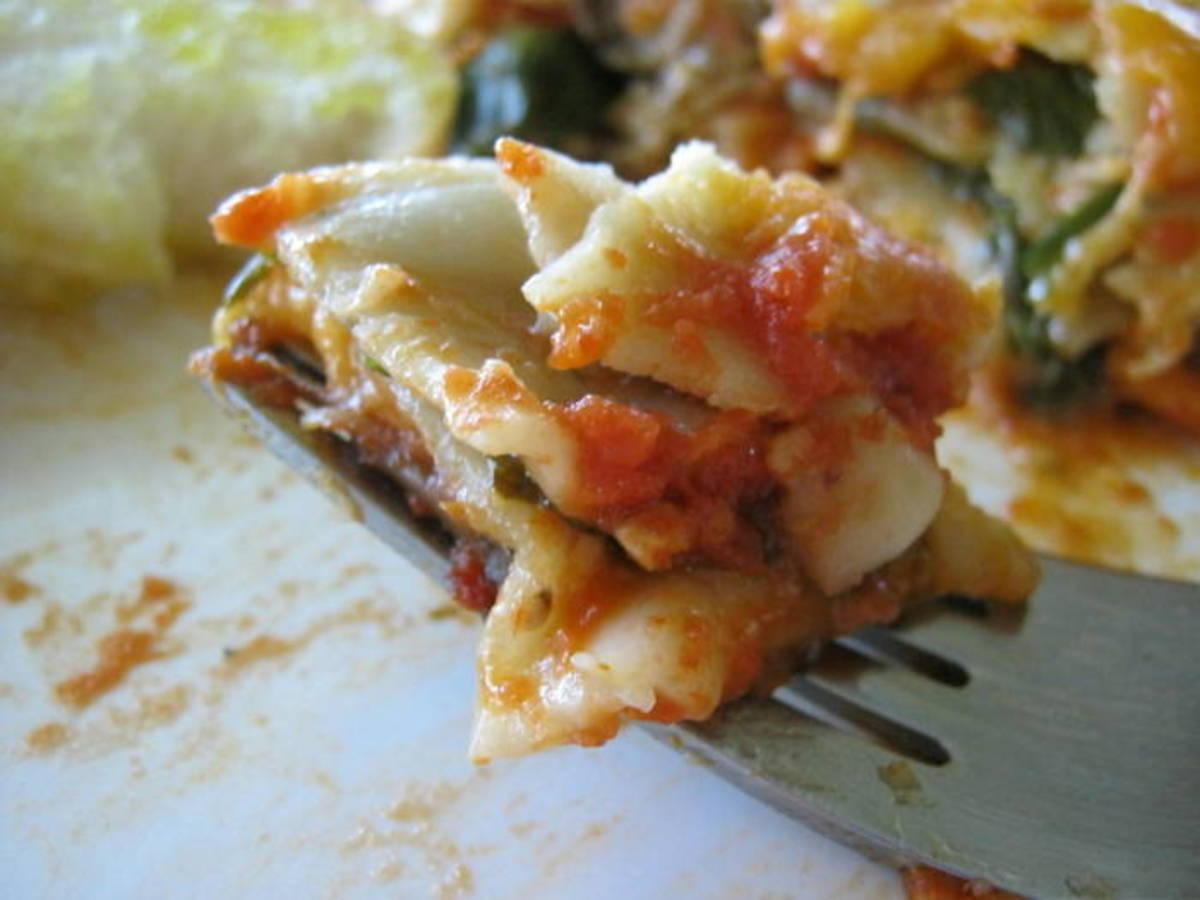 A bite of delicious vegetable lasagna.