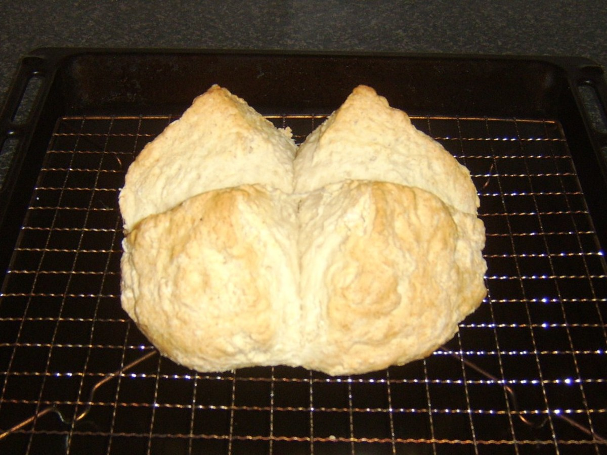 Soda bread is rested and cooled on a wire rack.