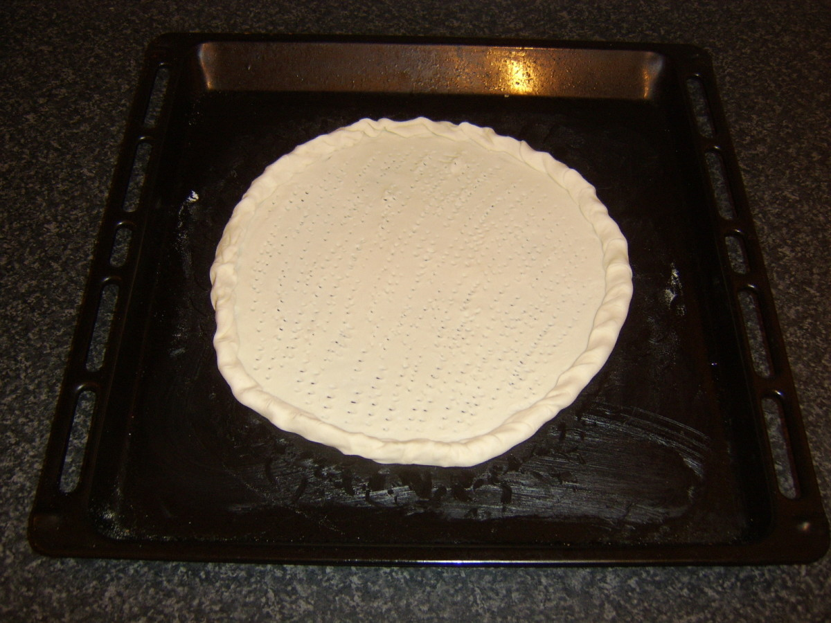 Crimped edge puff pastry circle is ready for first stage of cooking