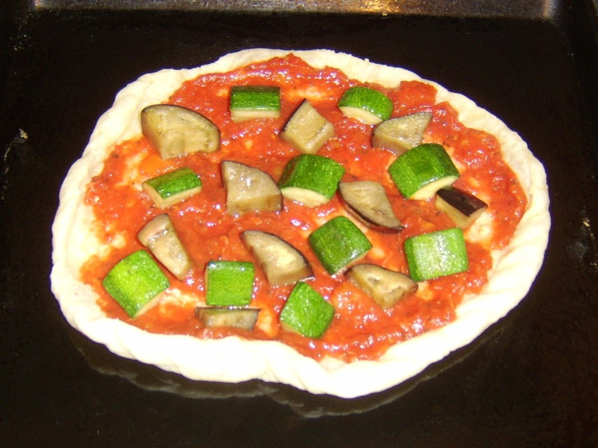 Courgette and aubergine added to puff pastry pizza