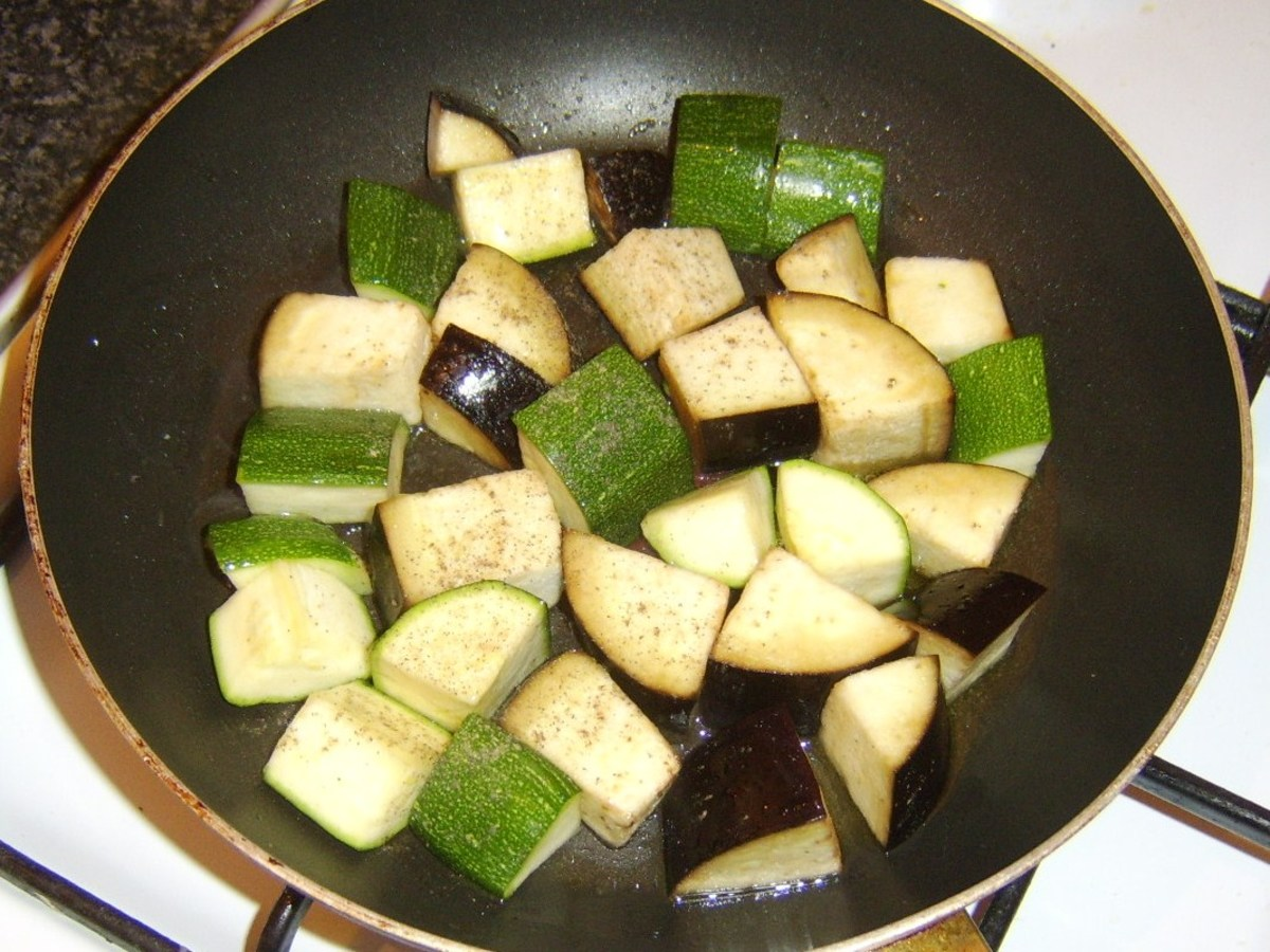 Briefly stir frying courgette and aubergine