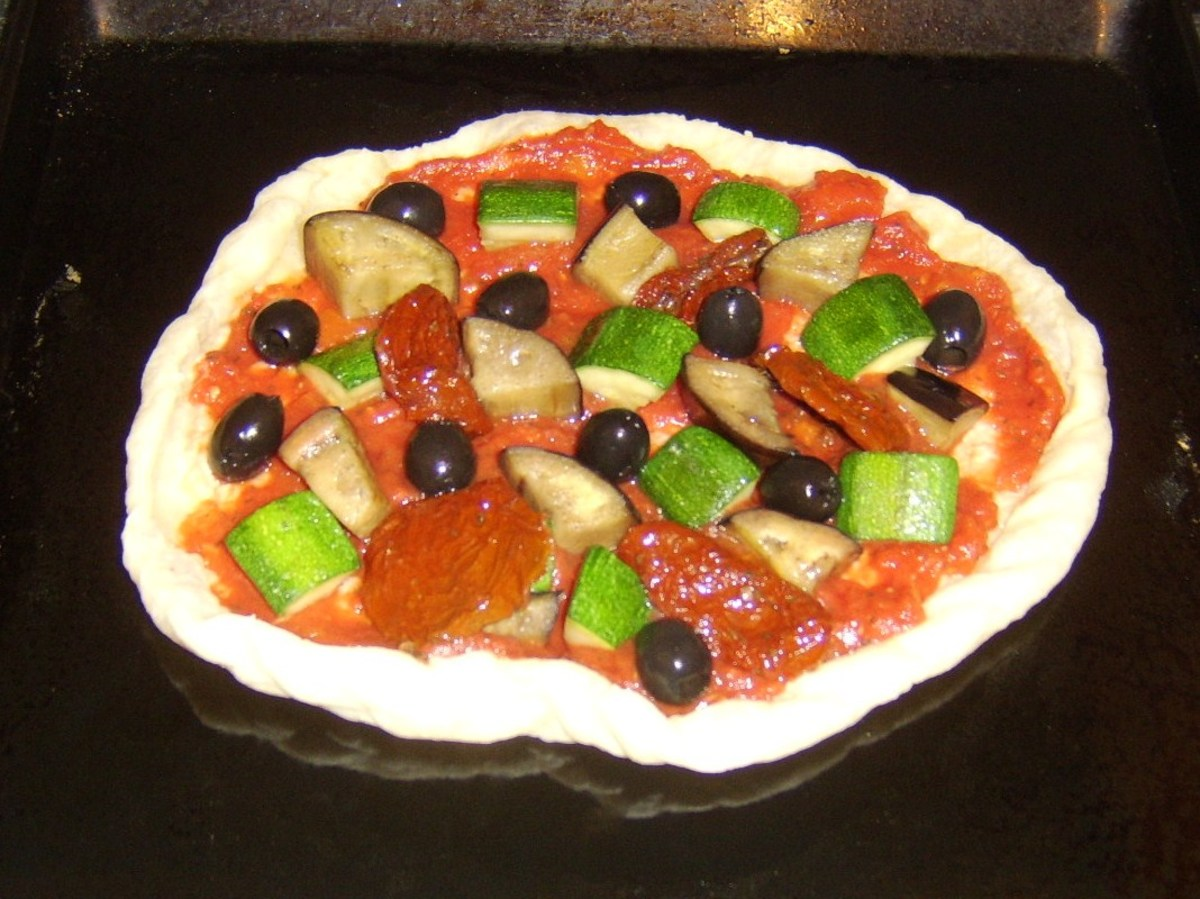 Sundried tomatoes and black olives are added to top of pizza