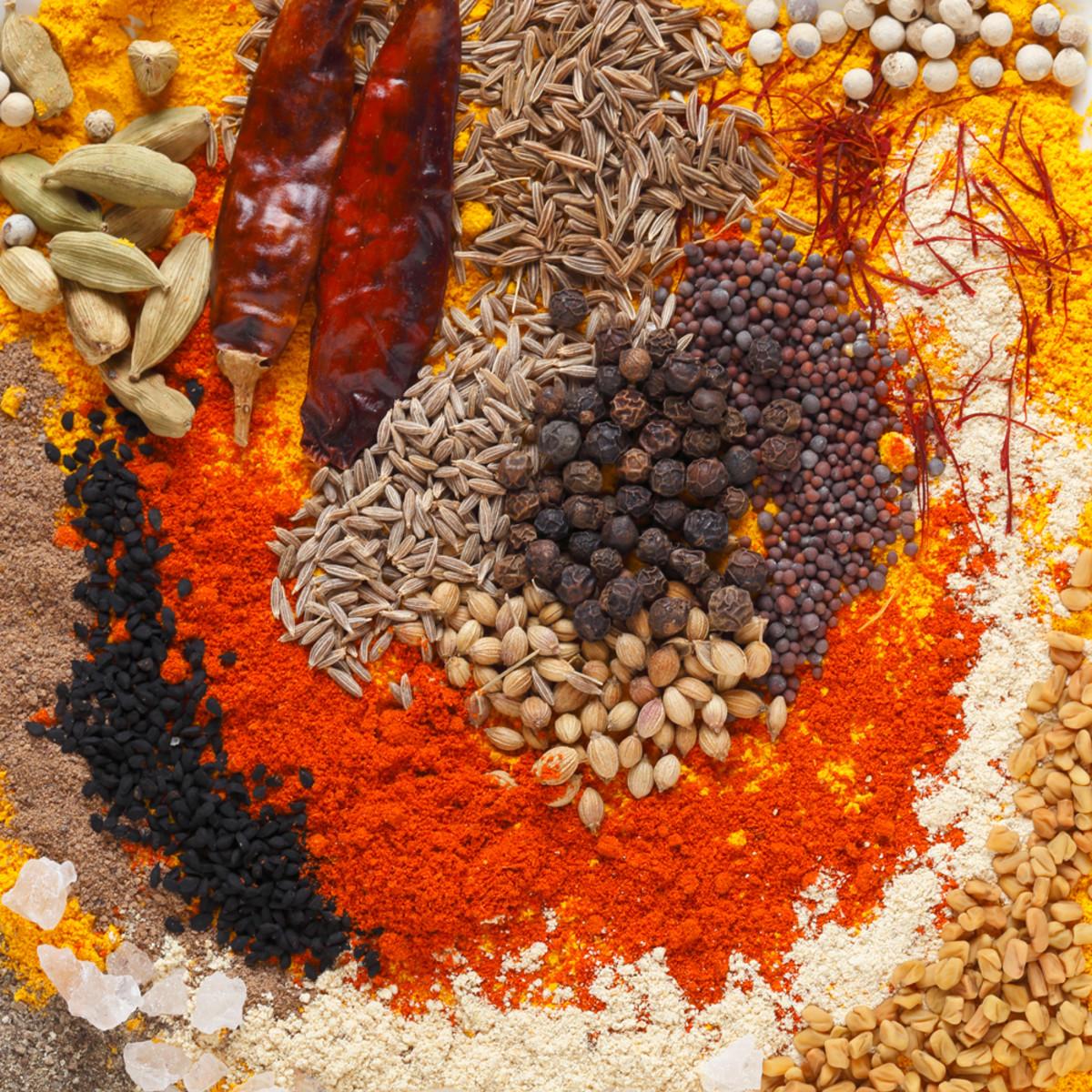 Curry spices: Black pepper, coriander seeds, black mustard seeds, cumin seeds; dried chillies, chilli powder, caraway seeds, saffron strands, white peppercorns, turmeric powder, fenugreek powder and seeds. Image:  © Paul_Cowan - Depositphotos.com