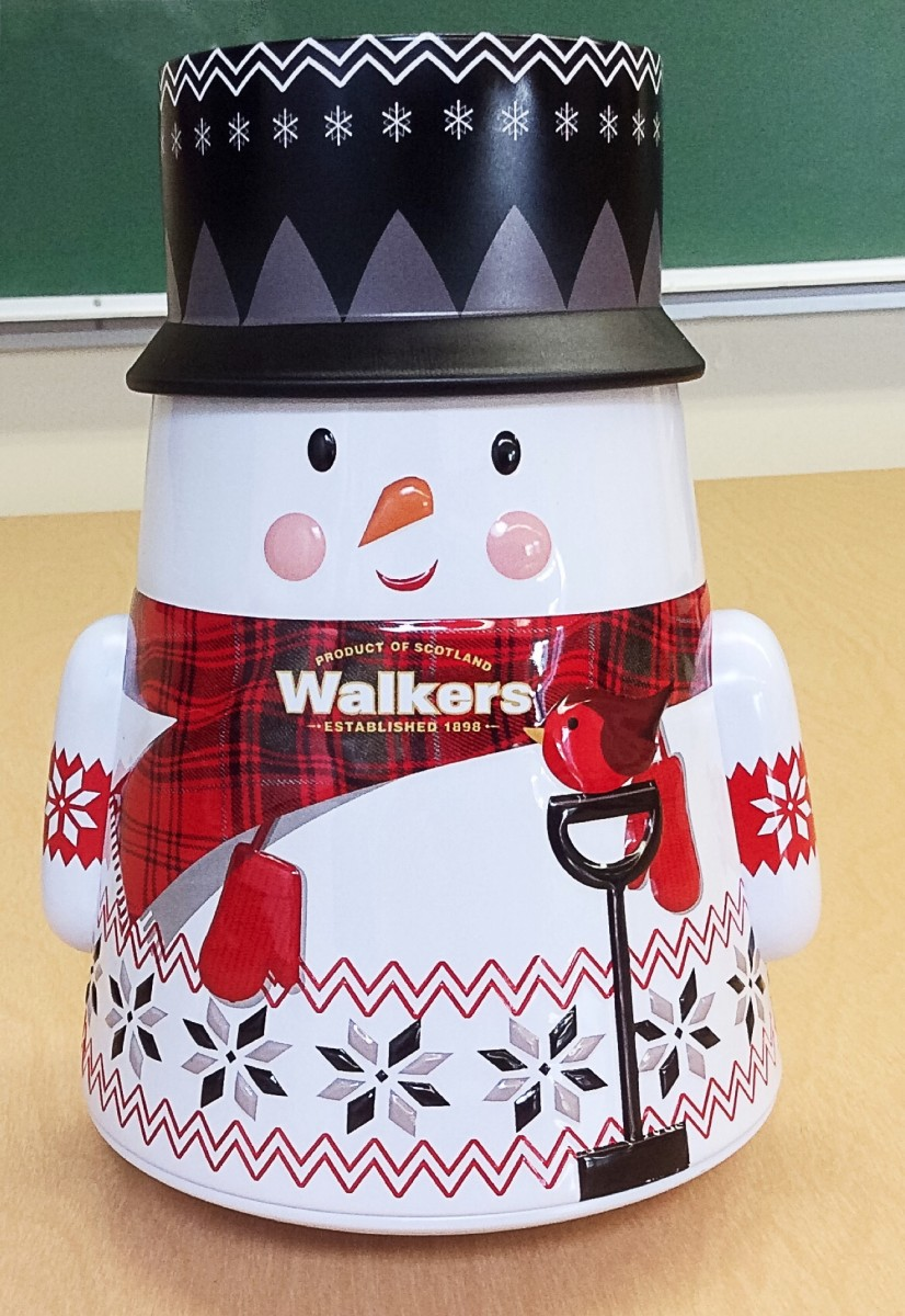 A snowman container for Walkers shortbread cookies
