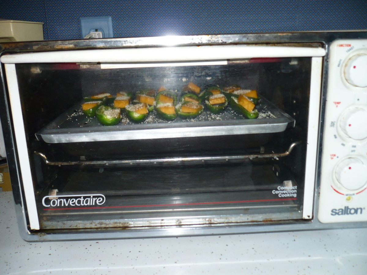 bake on 305 degrees for 30 minutes. TIP: Next time I try this I would roast the jalapeno peppers for 15 minutes then stuff with cheese, The way I did it the cheese melts and runs over onto the tray.