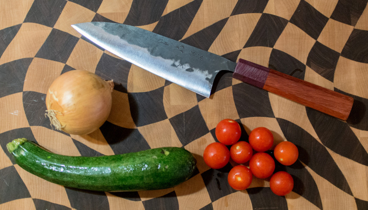 A freshly-honed carbon steel chef's knife.