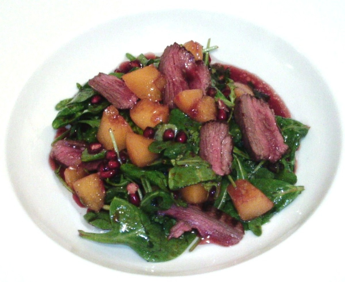 Thinly sliced kangaroo steak, peach and pomegranate salad