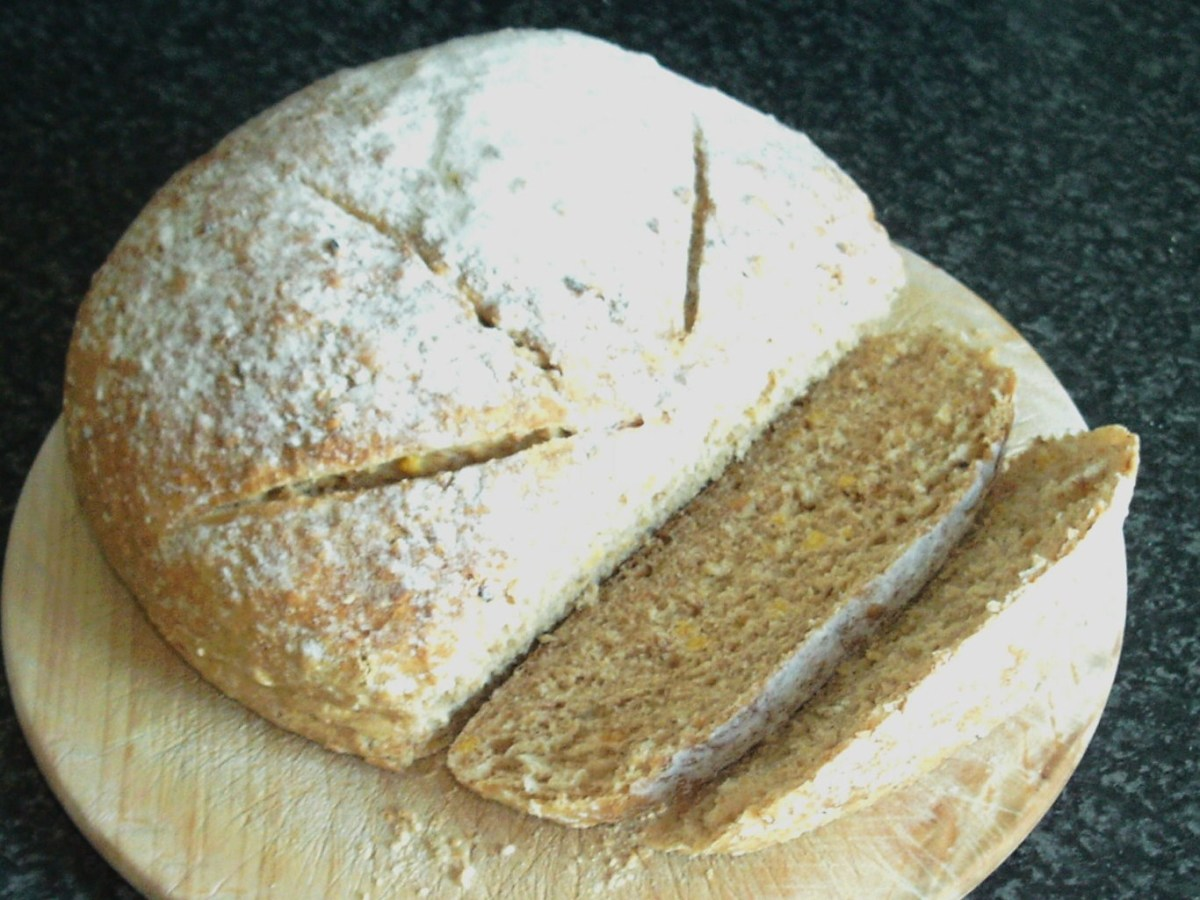 Slice of wheat, spelt and rye bread is cut to serve with kangaroo and vegetables