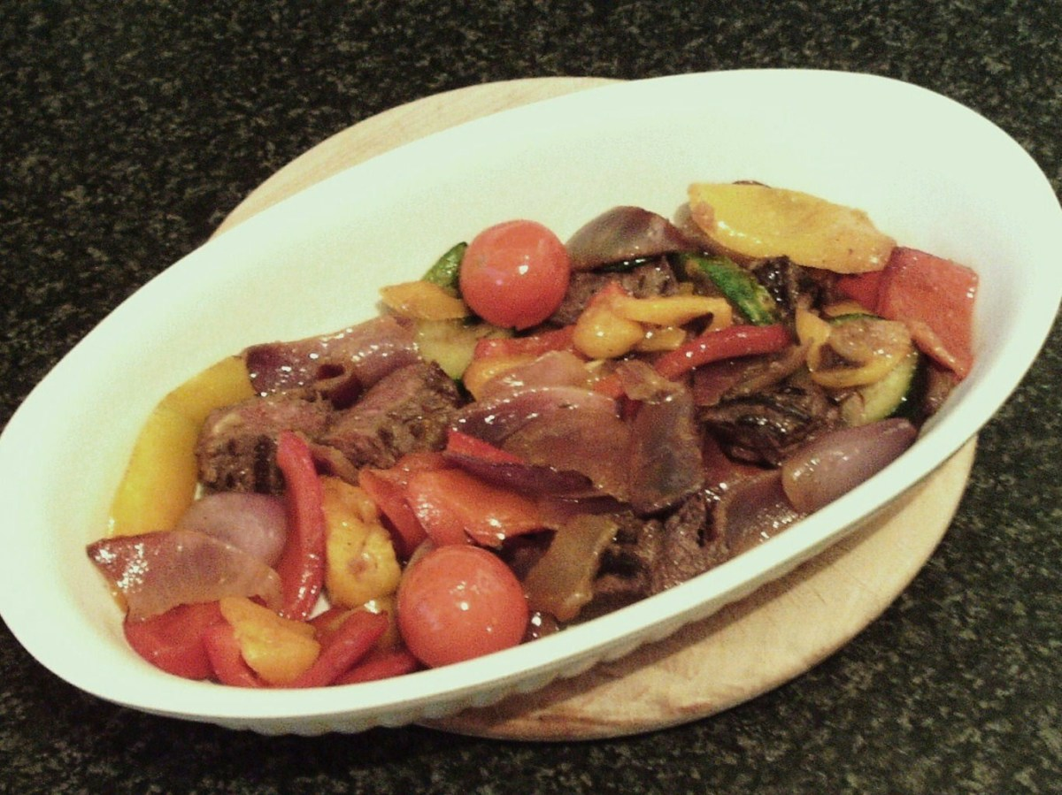 Kangaroo and roasted vegetables is added to serving plate
