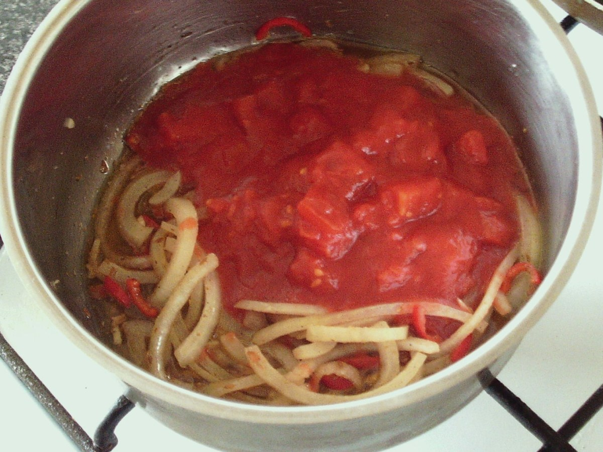Tomatoes are added to sauteed onion mix