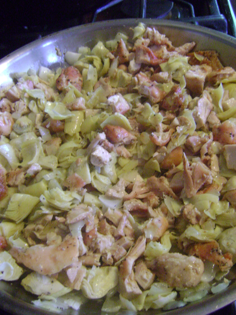 Sauteing the mixture allows all of the flavors of the garlic, onions, artichokes and chicken to marry before going into the casserole