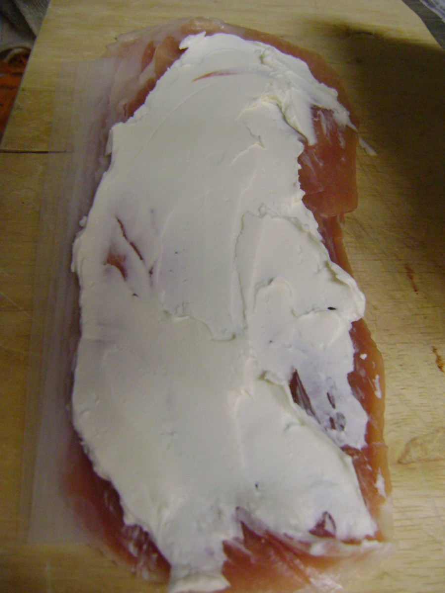 Spread 1 tablespoon of softened cream cheese on each slice of dried beef.