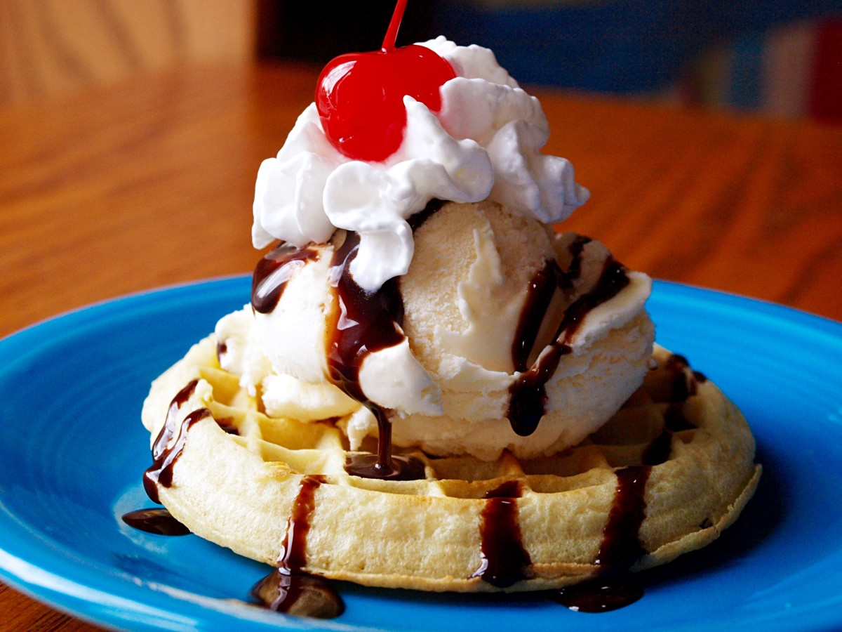 There aren't too many waffle toppings that can beat a scoop of vanilla ice cream, whipped cream and chocolate sauce.
