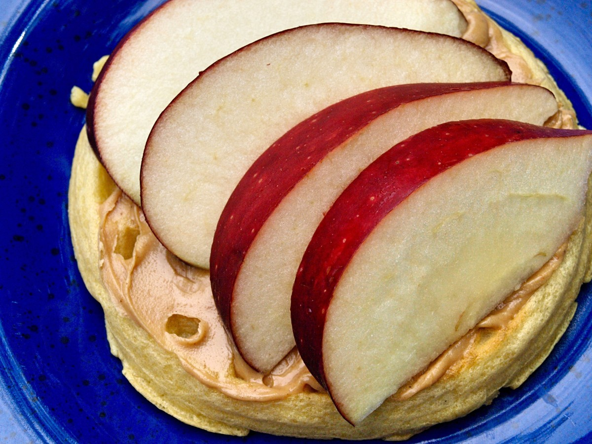 Apples and peanut butter are delicious and healthy toppings for a toasted waffle.