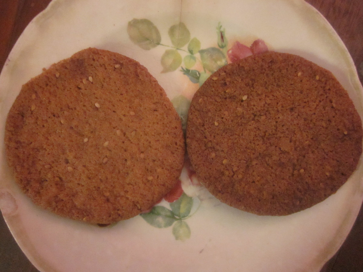 The cookie on the left is crunchy on the edges and chewy in the middle. The darker cookie on the right has been cooked until it is completely crunchy.