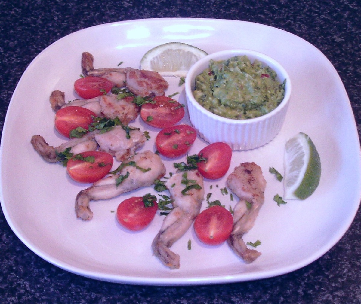 Fajitas spiced frogs' legs are served with a guacamole dip