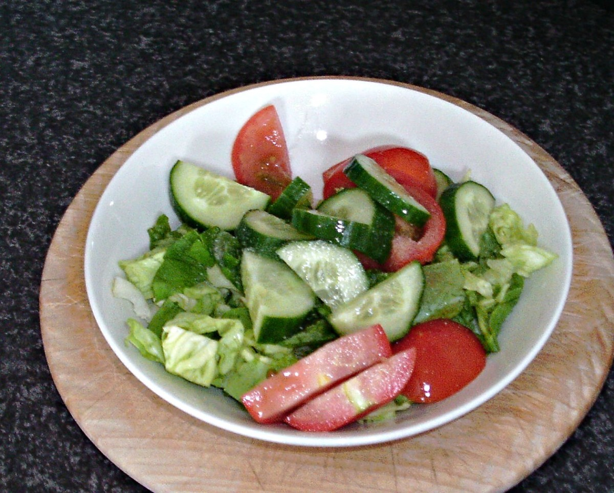 Salad is seasoned with salt, pepper and lemon juice