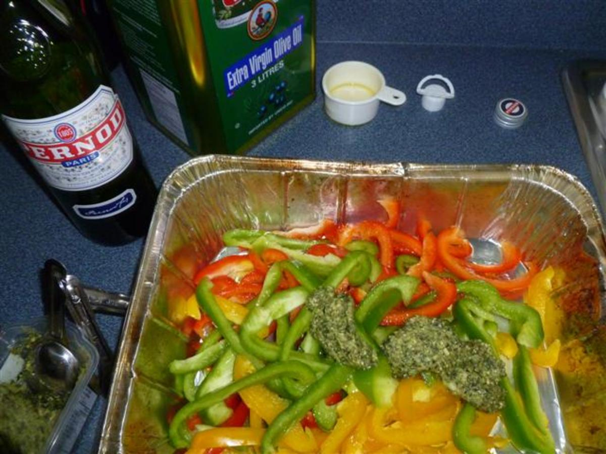 Now add the olive oil, pesto sauce and Pernod. Mix well to blend the ingredients and coat the peppers.
