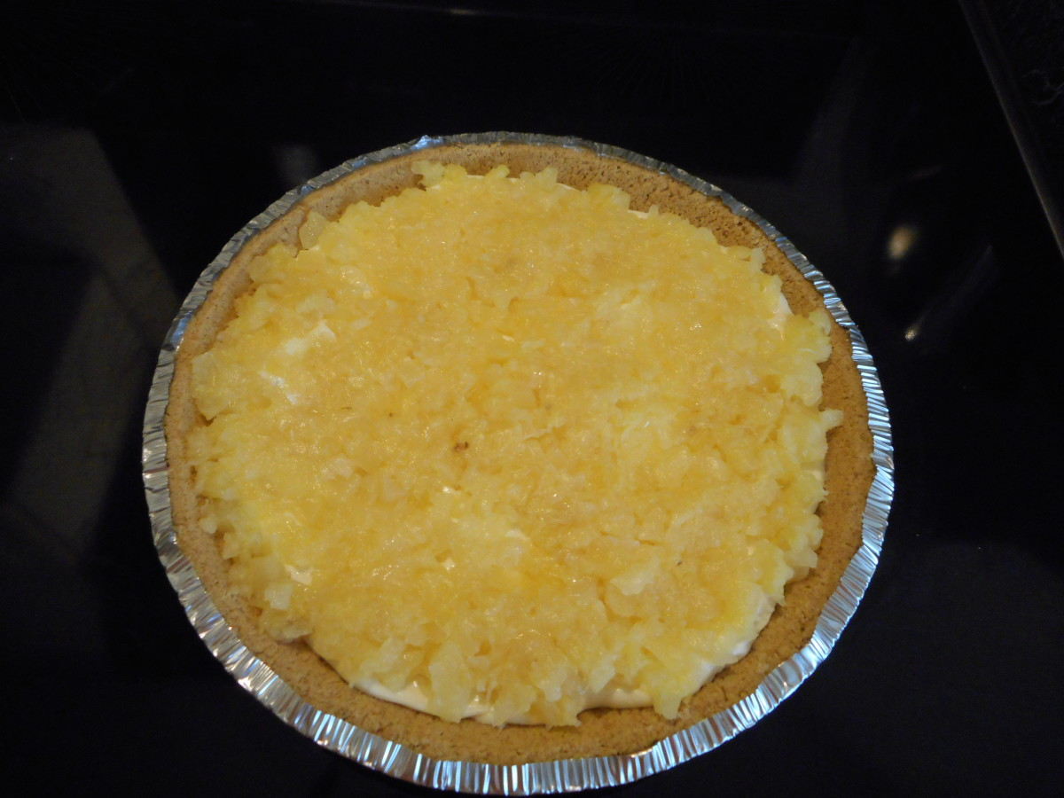 Spread crushed pineapple evenly over cream cheese mixture.