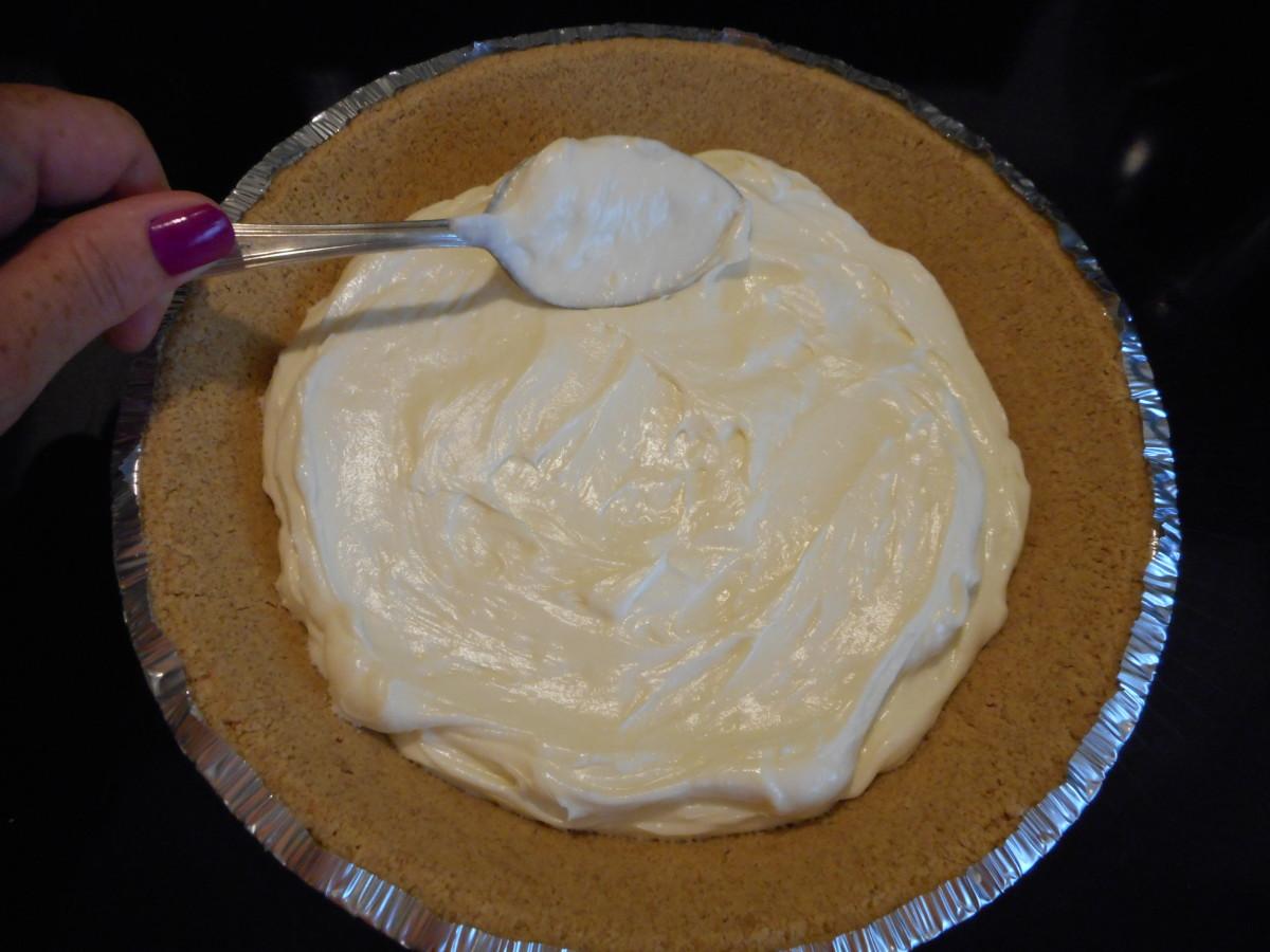 Spread cream cheese mixture evenly into pie crust.