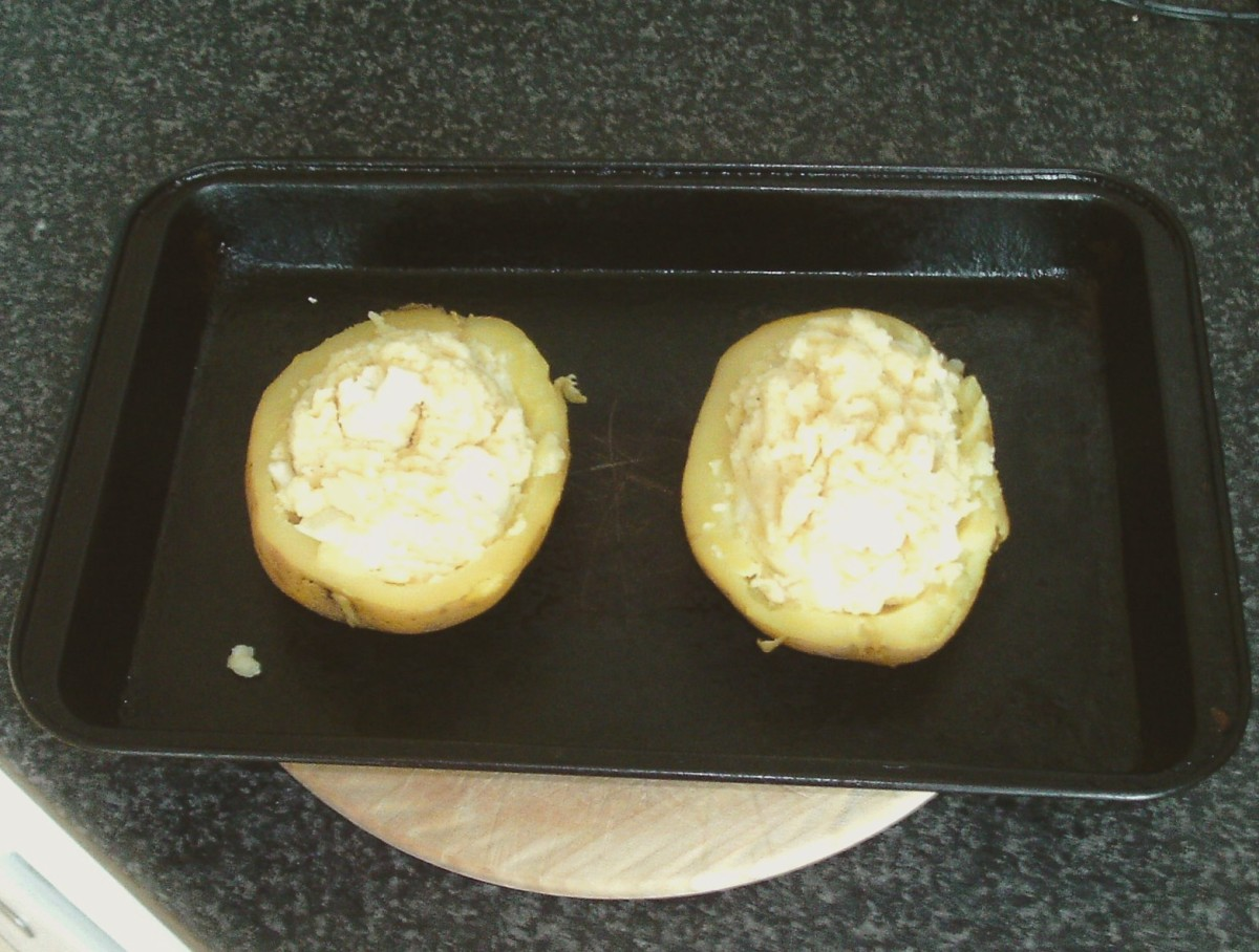 Stuffed potato halves ready for baking