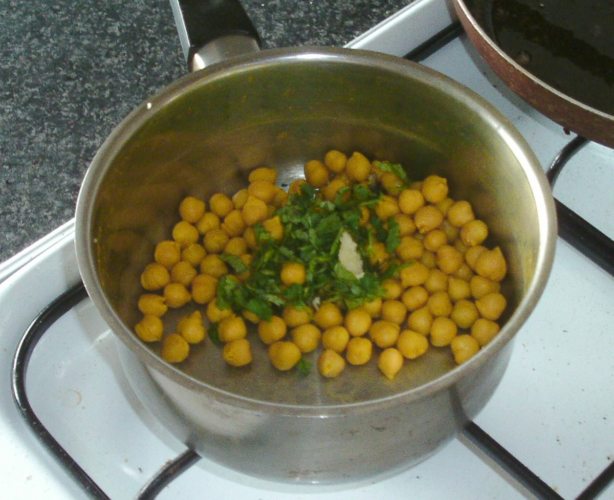 Coriander leaf/cilantro and garlic are added to chickpeas